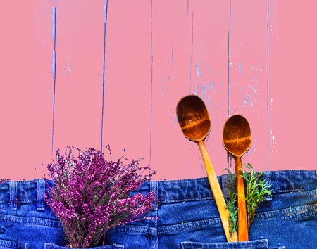Creative layout. Heather color and wooden spoons on denim texture.Closeup, copy space.