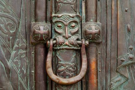 Vintage door handle with lion head. Closeup, copy space.