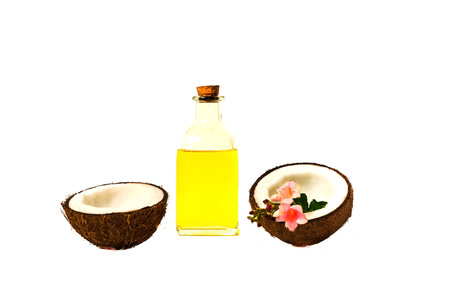 Coconut oil and fresh coconuts isolated on white background. Copy space, closeup