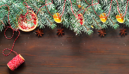 Christmas or new year composition with fir tree branches on wooden background. Holiday and celebration concept for postcard or invitation. Close-up, copy space Banque d'images - 125078816