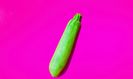 Fresh zucchini on bright trendy background. Close-up, copy space Imagens