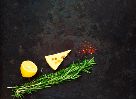 Rosemary and ingredients on vintage rustic metal background. Healthy eating concept. Close-up, copy space Stock Photo
