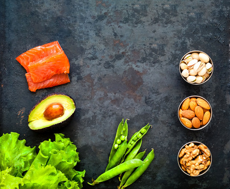 Ingredients for ketogenic diet on rustic black background. The concept of healthy eating. Close-up, copy space Stock Photo