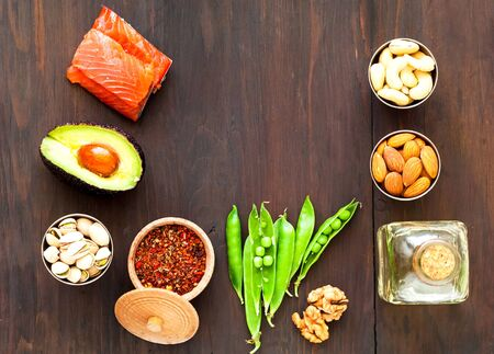 Ingredients for ketogenic diet on wooden background. The concept of healthy eating. Close-up, copy space Stock Photo