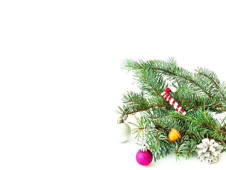 Pine spruce with New Years toys on white isolated background. Christmas background. Close-up, copy space Stock Photo