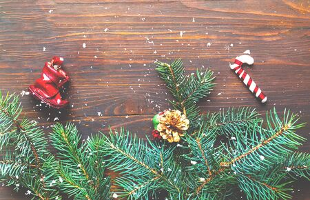 New Years decor. Decorative Christmas decorations on wooden background. Close-up, copy space