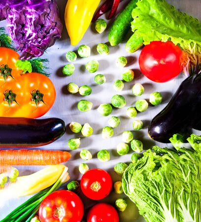 Fresh vegetables for healthy cooking on  wooden background. Closeup, copy space. Concept of vegetarian food