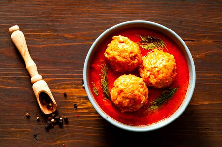 Meat balls in tomato sauce on wooden background.Close-up, copy space