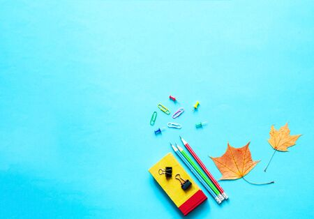 Back to school. School supplies on blue background.Close-up, copy space
