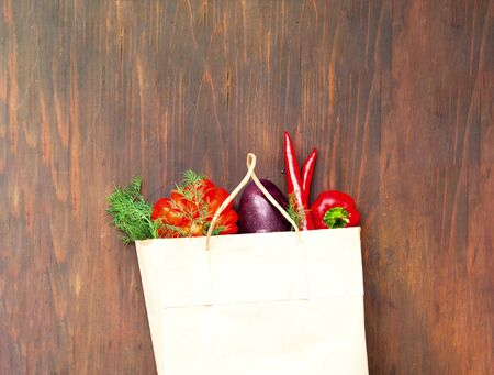 Paper bag with vegetables. Eco packaging concept. Close-up, copy space. Stok Fotoğraf