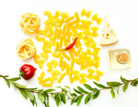 Various uncooked pasta with ingredients isolated on white background. Food concept. Close-up, copy space.