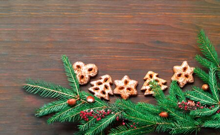 Homemade christmas gingerbread cookies on wooden background.  Close-up, copy space