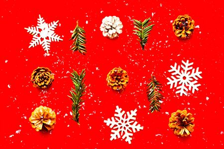 Christmas pattern of wooden decorations on red background. Zero waste Christmas concept. Copy space, close-up