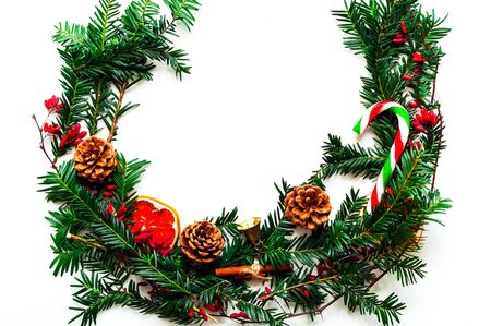 Christmas wreath on white isolated background. Festive background for decoration or projects. Copy space, close-up