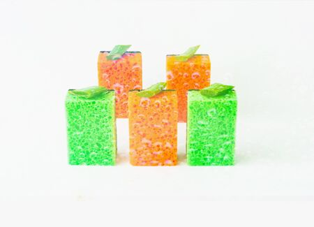 Colored sponges for organic cleaning on white isolated background. House cleaning. Close-up, copy space