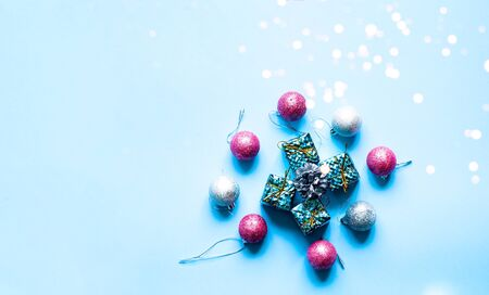 Christmas decorations and gift boxes on blue background. Festive background for decoration or projects. Copy space Stock Photo