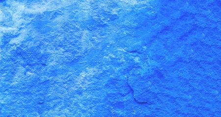 Blue background of natural cement or old stone.Vintage texture of decorative plaster or grungy marble. Trendy color 2020. Close-up