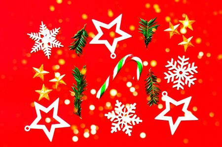 Christmas pattern of wooden decorations on red background. Zero waste Christmas concept. Copy space