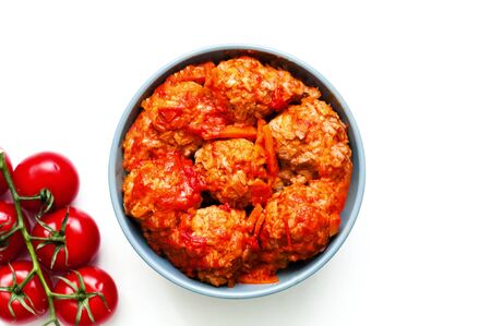 Meatballs in blue bowl on white isolated background. Close-up, copy space
