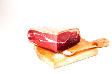 Authentic Italian Prosciutto Dry-Cured on wooden board. Air-Dried Ham. Close-up, isolated, copy space Stock Photo
