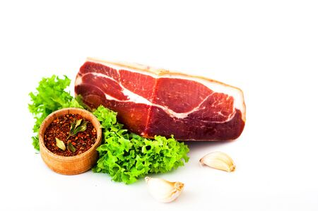 Spanish food.Serrano ham on white isolated background. Close-up, copy space Stock Photo