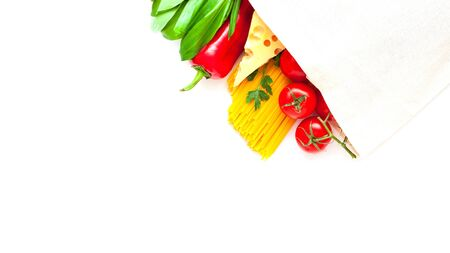 Eco bag with vegetables and spaghetti on white background. Ingredients for cooking, concept zero waste. Close-up, copy space