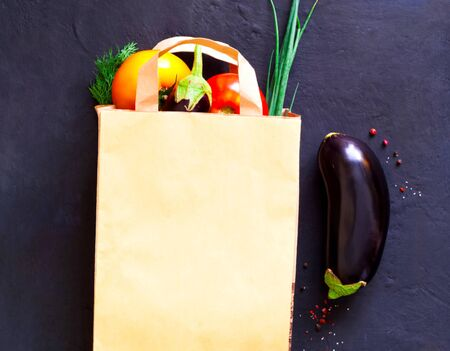 Food delivery in a paper bagd.Concept to prevent virus transmission.. Close-up, copy space Фото со стока