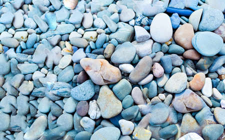 Marine background from natural stones. Close-up, creative copy space