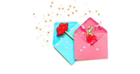 Pink and blue envelopes with decorative lips on stick. Festive concept or Romantic Love message. Creative copy space