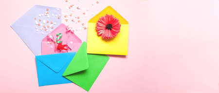 Abstract pink background with colorful envelopes. Festive concept or Romantic Love message. Creative copy space Фото со стока