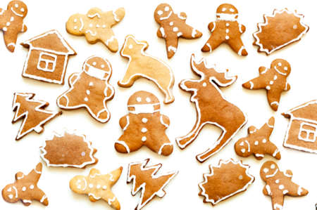 Pattern of gingerbread cookies on a white background. Christmas mood or food design. Creative copy space. Close-up Фото со стока