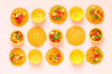 Waffle pattern with sweets. The sweetest day or National Waffle Day. Close-up