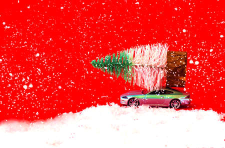 Christmas tree toy of fir tree on gray car. Christmas greeting card. Creative copy space. Фото со стока