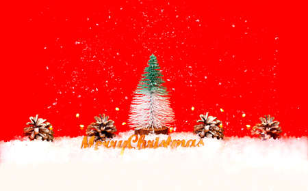 Christmas tree toy of fir tree and pine cones on red background. Christmas greeting card with place for your text.
