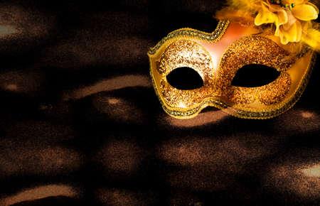 Golden Carnival mask on dark background. Mardi Gras concept. Creative copy space