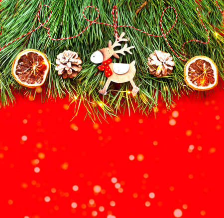 Christmas decor. Decorative wooden decorations on texture of pine branches. Concept of New Years. Creative copy space