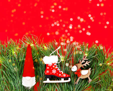 Christmas decor. Wooden decorations on texture of pine branches. Concept of New Years. Creative copy space Фото со стока