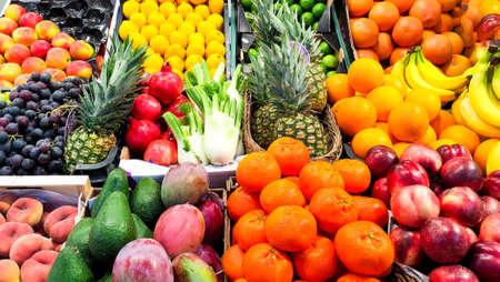 Exotic fruits on shop counter. Harvest festival or proper nutrition concept.