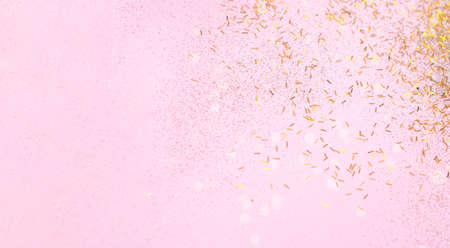 Abstract Pink background with gold sparkles. Creative space for design. Blurred effect