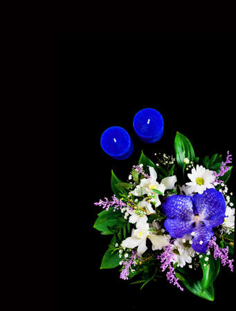 Trendy bouquet with flower of blue classic color on dark background. Romantic background with candles. Copy space