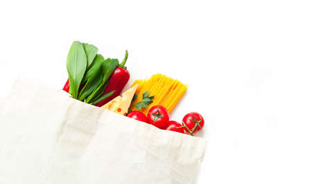 Eco bag with vegetables and spaghetti on white background. Ingredients for cooking. Close-up Фото со стока