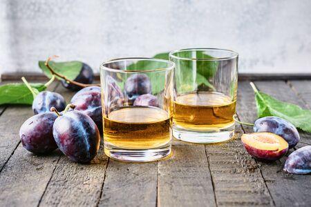 Plum alcoholic drink. Brandy Slivovica, and plum fruit.