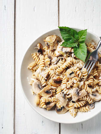 Fusilli pasta with mushrooms and cheese.