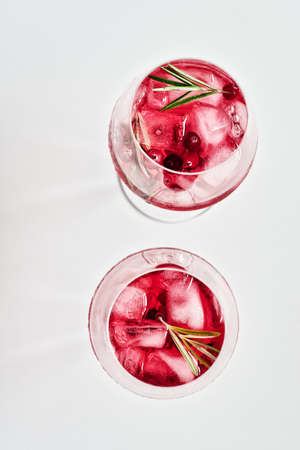 Cranberry rosemary spritzer drink on a light background.