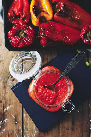 Freshly made sauce, ajvar appetizer with roasted bell pepper and garlic. Фото со стока