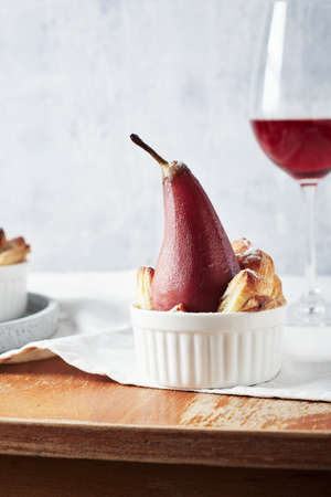 Poached pears in red wine with cinnamon.