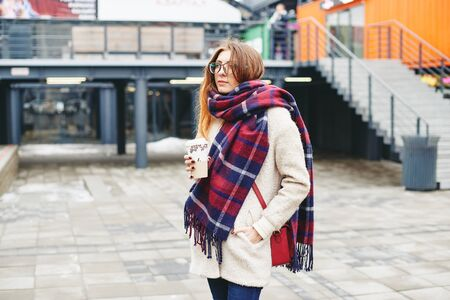 Girl with coffee winter street style
