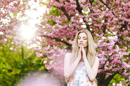 nature beauty: Spring portraits gorgeous young woman on  cherry blossom background