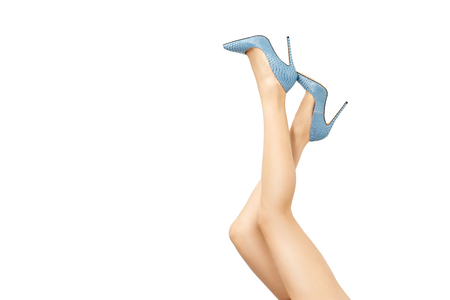 Beautiful female legs in high heel shoes isolated on white background