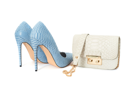 Blue high heel shoes with small stylish handbag isolated on white background